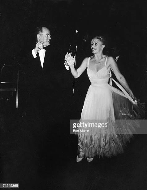 American politician and future US Vice President Hubert Humphrey dances with American actress Ginger Rogers at a party in celebration of the 40th...