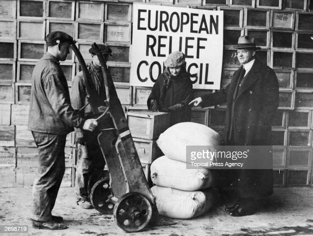 American politician and later the 31st President of the United States Herbert Hoover overseeing the shipping of relief supplies to postwar Europe...