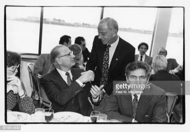 American politician and leader of the Kings County Democratic Party Meade Esposito shakes hands with attorney Roy Cohn during a CitymealsonWheels...