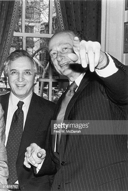 American politician and Mayor of New York City Ed Koch points out something to Village Voice founding editor Daniel Wolf at Koch's mayoral...