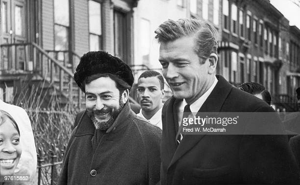 American politician and Mayor of New York John V Lindsay walks with journalist and music critic Nat Hentoff during an inspection of Brooklyn streets...