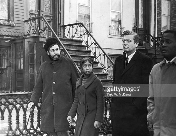 American politician and Mayor of New York John V Lindsay walks with journalist and music critic Nat Hentoff and several unidentified others during an...