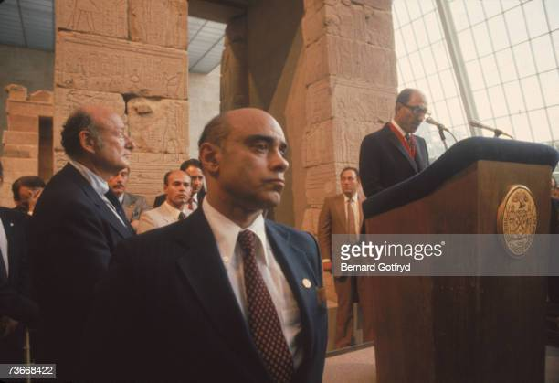 American politician and New York mayor Ed Koch watches as Egyptian President Anwar Sadat speaks from a lecturn in the Metropolitan Museum of Art New...