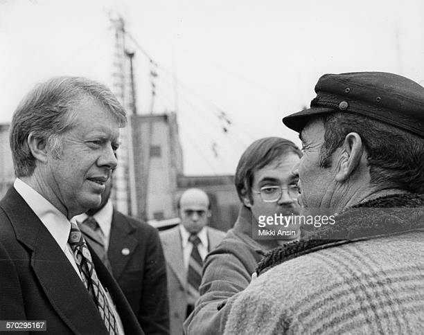 American politician and Presidential candidate Jimmy Carter speaks with fishermen about fishing rights in New Bedford Massachusetts 1976