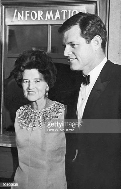 American politician and senator Edward Kennedy and his mother Rose Fitzgerald Kennedy pose together in front of an information kiosk as they attend...