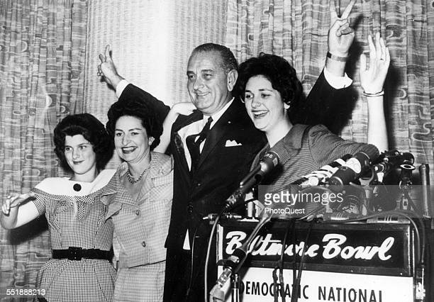 American politician and Senator Lyndon B Johnson and his family wave during a press conference before the Democratic National Convention where he...
