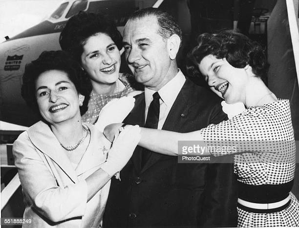 American politician and Senator Lyndon B Johnson poses with his family at an unspecified airfield before the Democratic National Convention where he...