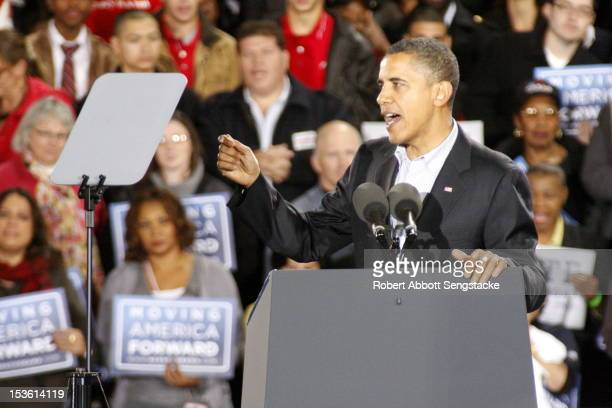 American politician and US President Barack Obama speaks from a podium during the 'Moving America Forward' rally, Chicago, Illinois, October 30,...
