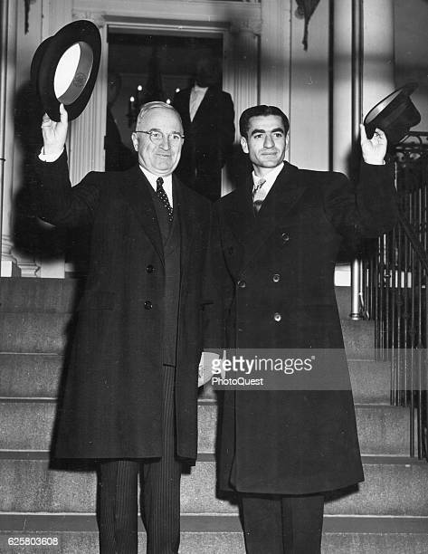 American politician and US President Harry S Truman and Shahinshah of Iran Mohammad Reza Pahlavi wave from steps of Blair House during the latter's...
