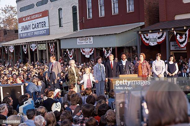 American politician and US President Jimmy Carter and his family stand on a platform amid a crowd on W Main Street Plains Georgia January 21 1977 He...