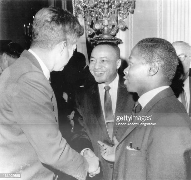 American politician and US President John F Kennedy shakes hands with newspaper publisher John H Sengstacke early 1960s