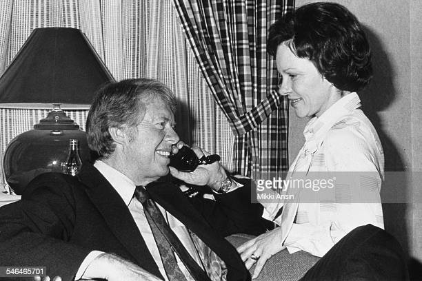 American politician and US Presidential candidate Jimmy Carter and his wife Rosalynn Carter talk on the telephone after his victory in the...