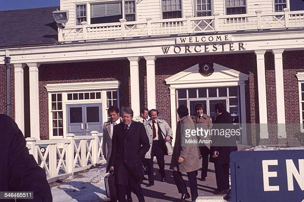 American politician and US Presidential candidate Jimmy Carter leaves the terminal at Worcester Regional Airport as he prepares to board a plane...