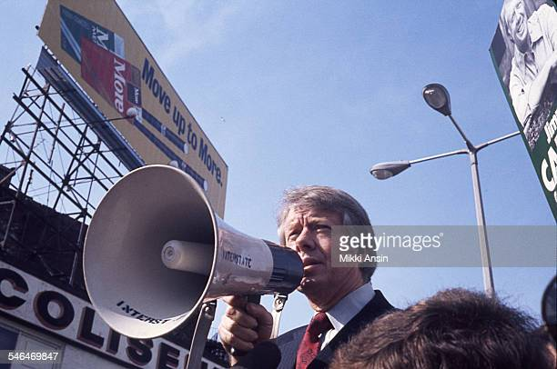American politician and US Presidential candidate Jimmy Carter uses a megaphone as he speaks during a campaign event Boston Massachusetts 1976