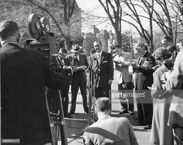 American politician and US Senate Majority Leader Lyndon B Johnson talks to reporters at an outdoor press conference, Washington DC, May 31, 1955. He...