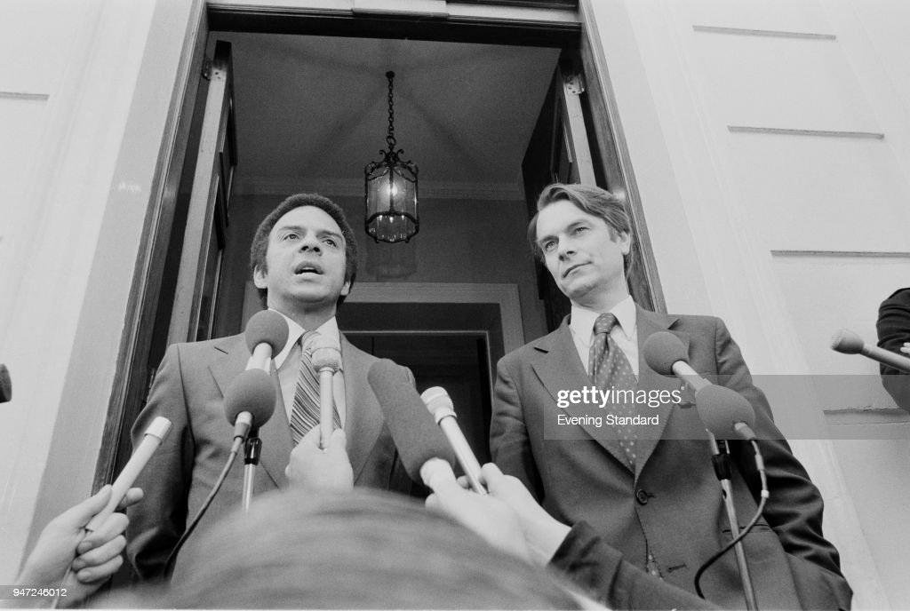 American politician, diplomat, and activist Andrew Young and British politician and physician David Owen, Foreign Secretary, talking to the press after a meeting, Carlton House, London, May 26th 1977.