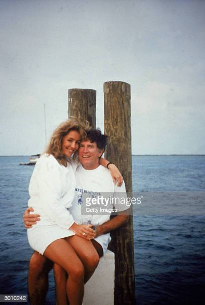 American politician Gary Hart sits on a dock with Donna Rice on his lap 1987