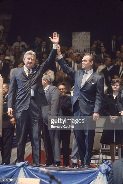 American politician George C Wallace the American Independent Party candidate for the US presidency raises hands with his running mate American...