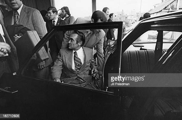 American politician George Wallace is helped into his chauffeur driven car Belgium 1975