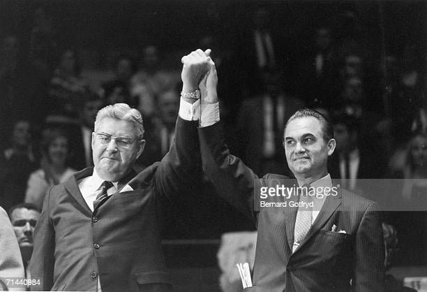 American politician George Wallace the American Independent Party candidate for the US presidency holds hands with his runningmate Gerneral and...