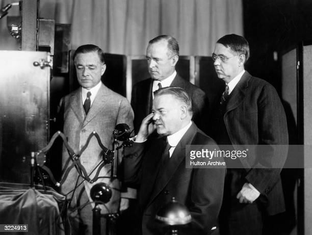 American politician Herbert Hoover then Secretary of Commerce taking part in the first public demonstration of intercity television broadcasting in a...