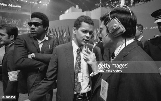 American politician Julian Bond , Congressman from Georgia and future head of the NAACP, answers questions from journalist Dan Rather on the floor at...