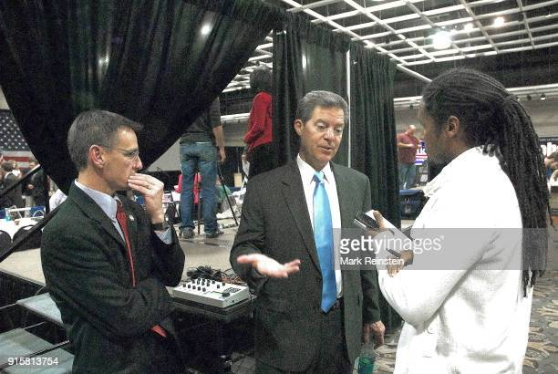 American politician Kansas Governor Sam Brownback talks to journalist John Eligon of the New York Times at an election night party in the Capitol...
