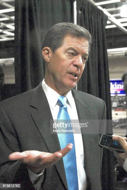 American politician Kansas Governor Sam Brownback talks to the press at an election night party in the Capitol Plaza Hotel ballroom Topeka Kansas...