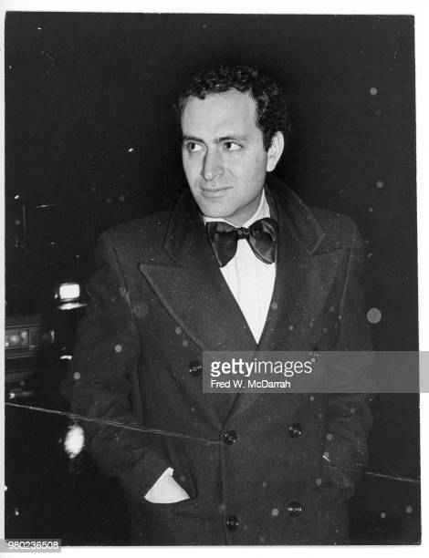 American politician New York State Assemblyman Chuck Schumer hands in the pockets of his overcoat arrives at the Studio 54 nightclub for Roy Cohn's...