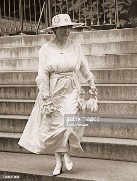 American politician , politicial activist, and social reformer Jeannette Rankin walks down the steps as she leaves the White house, Washington DC,...