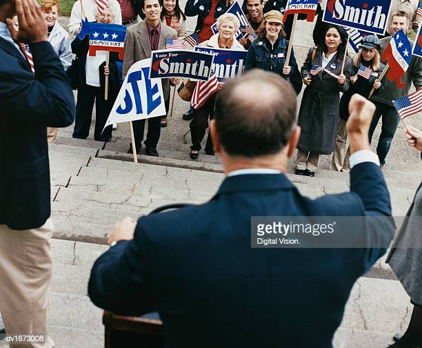 American Politician Presenting a Speech to a Large Crowd of Supporters