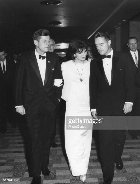 American politician President John F Kennedy First Lady Jacqueline Kennedy and their brotherinlaw Director of the Peace Corps Sargent Shriver as they...