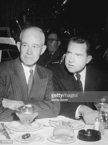 American politician Richard Milhous Nixon sits at a dining table next to US Army general Omar Bradley during Nixon's California gubernatorial...