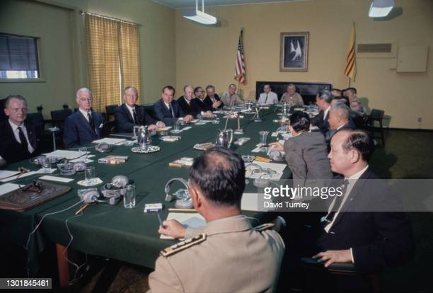American politician Richard Nixon during a meeting with South Vietnamese President Nguyen Van Thieu and aides seated at large table, where they...