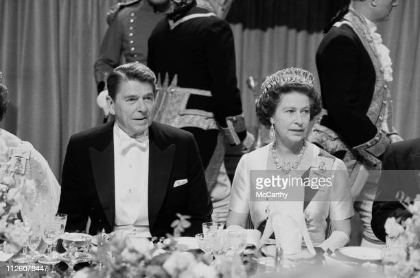 American politician Ronald Reagan 40th President of the United States and the Queen of the United Kingdom Elizabeth II at a gala dinner at Windsor...