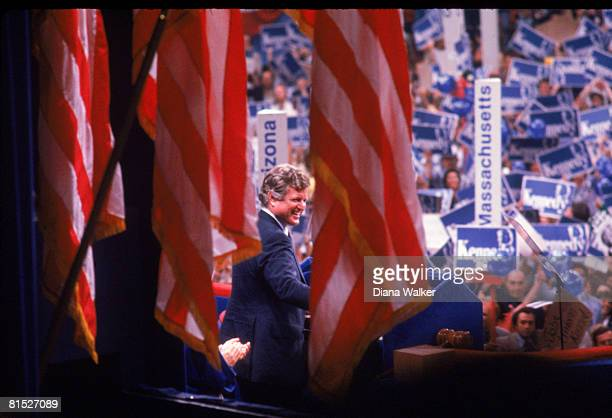 American politician Senator Edward Kennedy is framed between American flags as he delivers a speech at the Democratic National Convention in Madison...