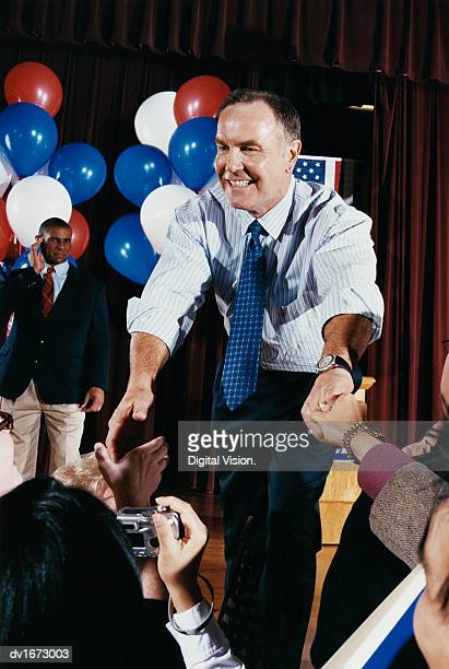 American Politician Shaking Hands with Supporters at a Political Rally