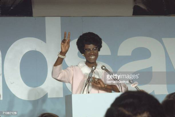 American politician Shirley Chisholm congresswoman from New York smiles and waves from behind the podium at a press conference October 1969