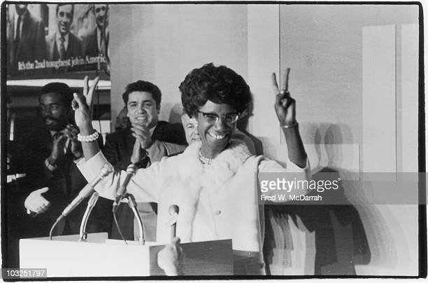 American politician Shirley Chisholm on election night as she gives the 'v for victory sign' from a podium after winning her second term as...