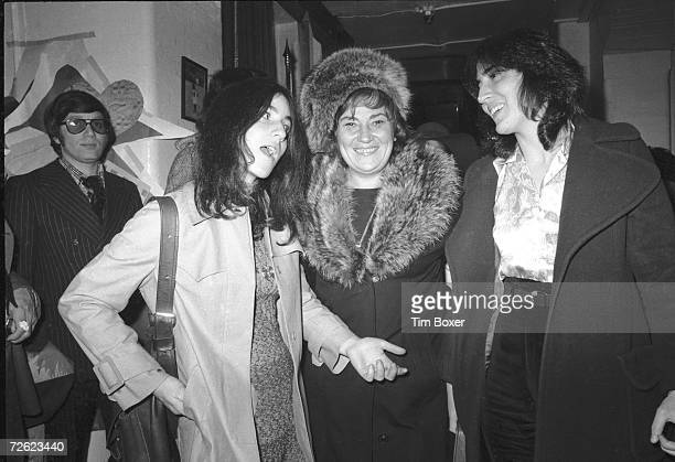 American politician social political activist and feminist icon Bella Abzug shares a laugh with her two daughters law student Liz and sculptor Eve...