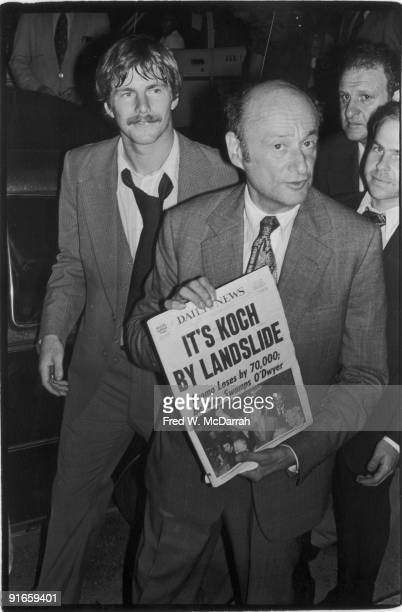 American politician soontobe threeterm mayor of New York City Ed Koch holds up a copy of New York Daily News which sports the headline 'It's Koch by...