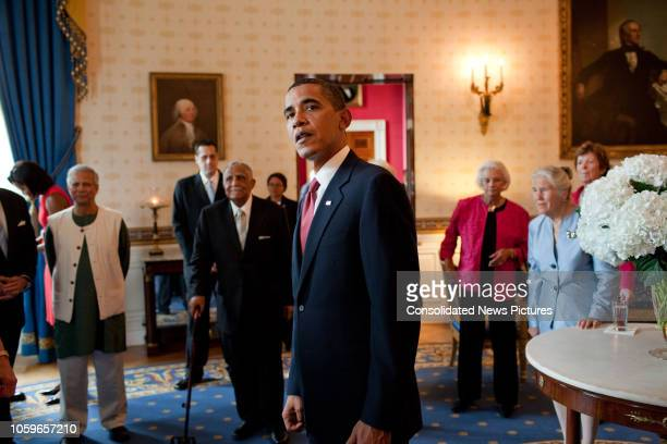 American politician US President Barack Obama waits in the Blue Room of the White House with Presidential Medal of Freedom honorees before their...