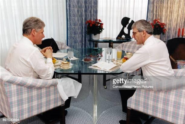 American politician US President Bill Clinton and British Prime Minister John Major meet over breakfast in the White House's Solarium, Washington DC,...