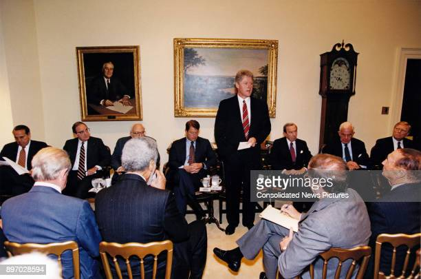 American politician US President Bill Clinton consults with a bipartisan group of Congressional leadership in the White House's Roosevelt Room...