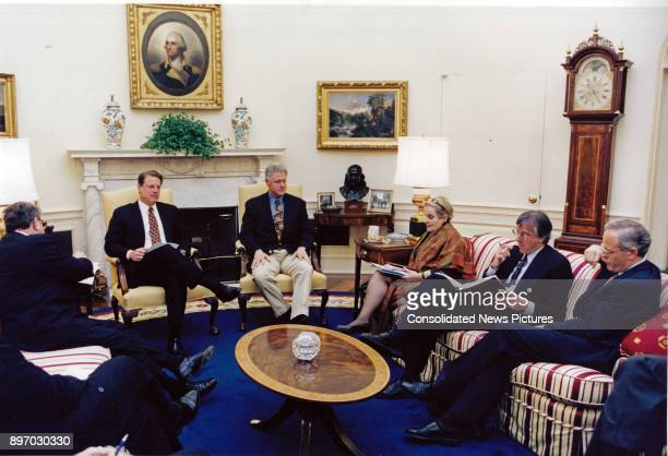 American politician US President Bill Clinton hosts a cabinet meeting in the White House's Oval Office Washington DC May 11 1998 Pictured are from...