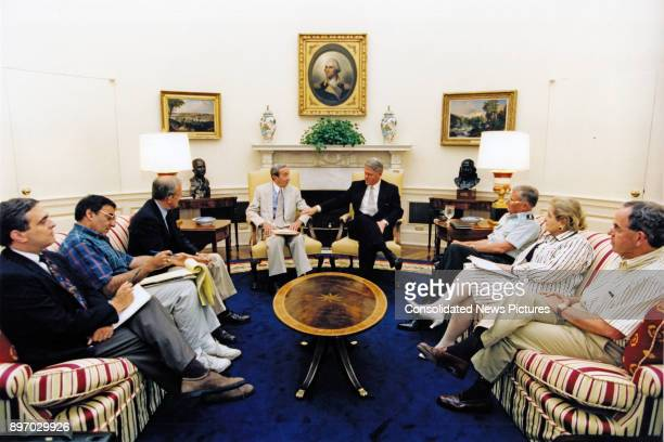 American politician US President Bill Clinton meets with advisors in the White House's Oval Office Washington DC July 22 1995 Pictured are from left...