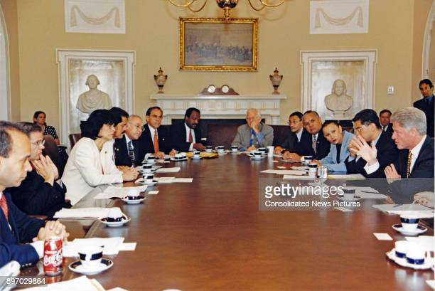 American politician US President Bill Clinton meets with members of the Congressional Hispanic Caucus in the White House's Cabinet Room Washington DC...