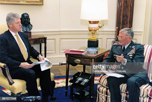 American politician US President Bill Clinton receives a briefing from the Chairman of the Joint Chiefs of Staff US Army General John Shalikashvili...