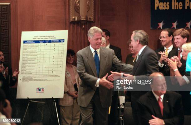 American politician US President Bill Clinton shakes hands with US Senator Tom Harkin at an event in the Dirksen Senate Office Building on Capitol...