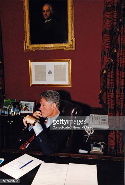 American politician US President Bill Clinton speaks on the telephone from his study in the White House residence Washington DC September 21 1993 he...